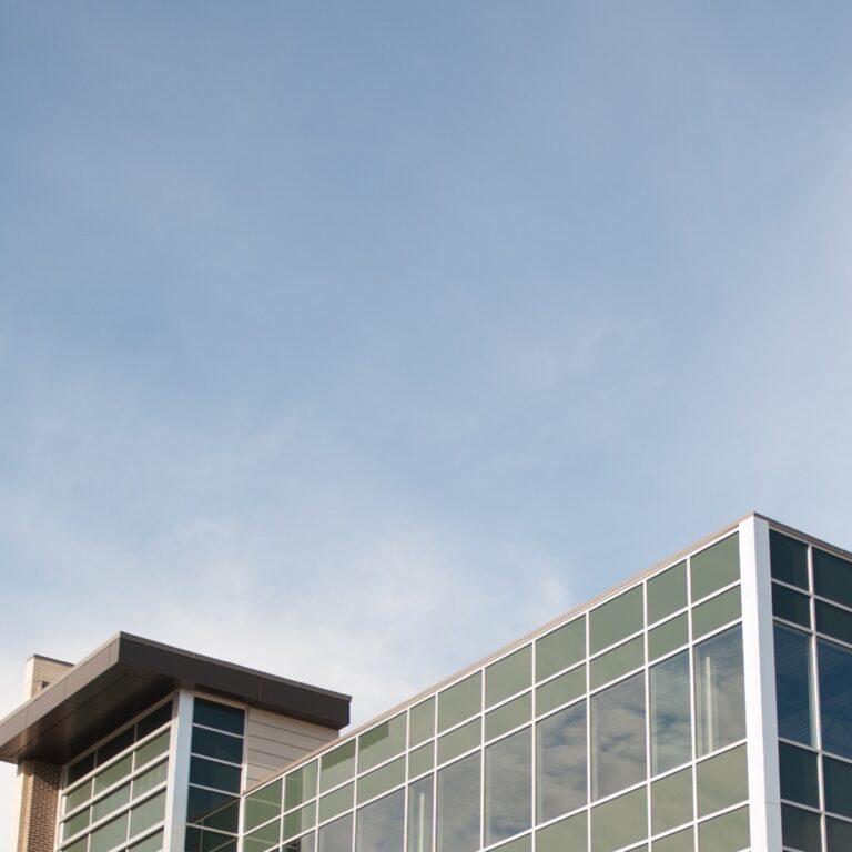 Office block against a blue sky